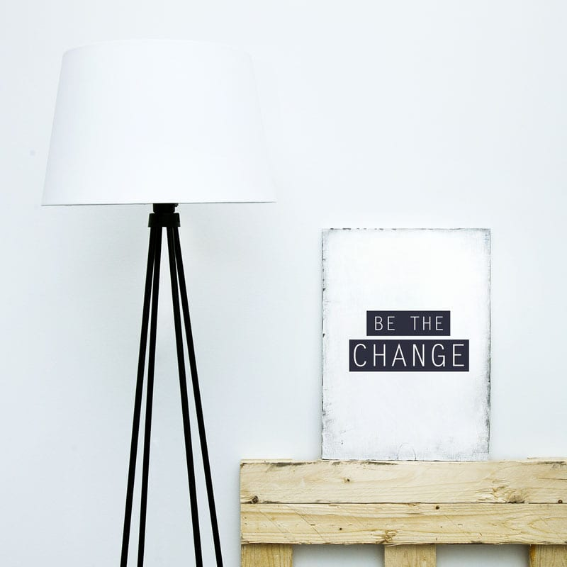 Motivational hipster board BE THE CHANGE with lamp. Scandinavian style room interior